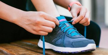 Exercise shoes being laced up