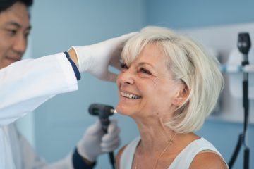 Older woman undergoing a hearing check as part of her diabetes management