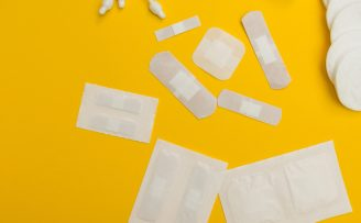 band aids of various sizes on a yellow background