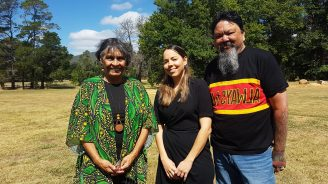 Three aboriginal and torres strait islander people one man and two women standing together in support of diabetes health