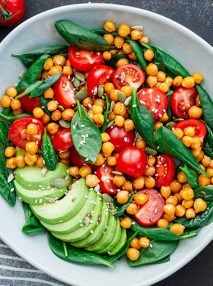 Avocado and chickpea salad with cherry tomato, basil and seeds