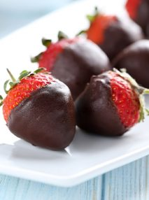 plate of chocolate dipped strawberries ona white plate